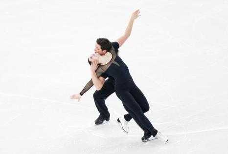 Тесса Вирту и Скотт Мойр откатали свою программу на тренировке в Сочи 5 февраля перед Олимпийскими играми 2014. Фото: Matthew Stockman/Getty Images