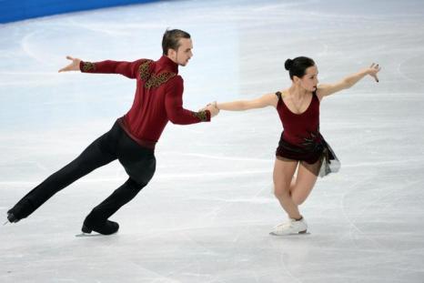 Пара Ксения Столбова и Фёдор Климов выступают с короткой программой 11 февраля в ходе сочинской Олимпиады. Фото: JUNG YEON-JE/AFP/Getty Images