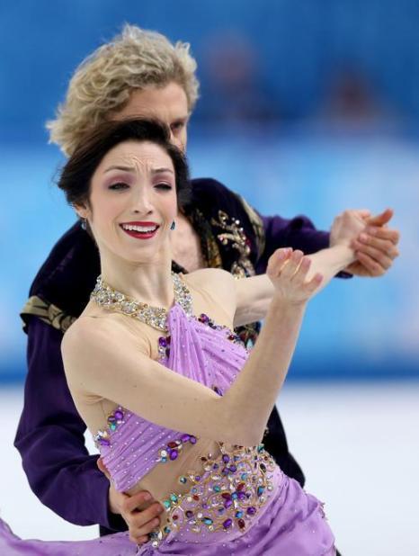 Мерил Дэвис и Чарли Уайт из США стали обладателями «золота» в танцах на льду на Олимпиаде 17 февраля 2014 года. Фото: Clive Mason/Getty Images