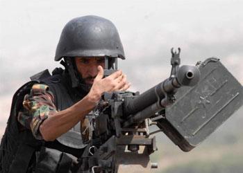 Член антитеррористического подразделения на специальных учениях в горной местности в Йемене. Фото: Khaled Fazaa/AFP/Getty Images