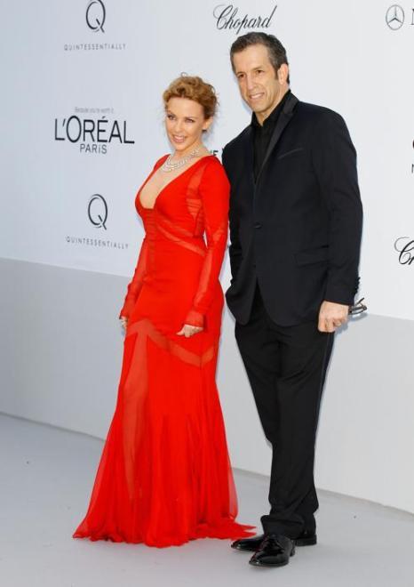 Знаменитости на мероприятии 2012 amfARs Cinema Against AIDS во Франции. Kylie Minogue; Kenneth Cole. Фоторепортаж. Фото: Andreas Rentz/Getty Images