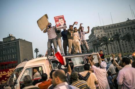Братья-мусульмане празднуют предположительную победу своего кандидата на выборах в президенты 18 июня 2012. Фото: Daniel Berehulak /Getty Images