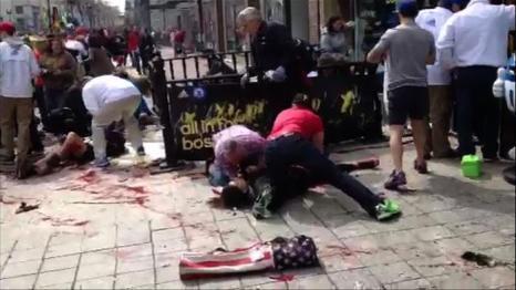 Теракт в Бостоне унёс жизни 3 человек, более 140 ранены. Фото: Marc Hagopian/AFP/Getty Images