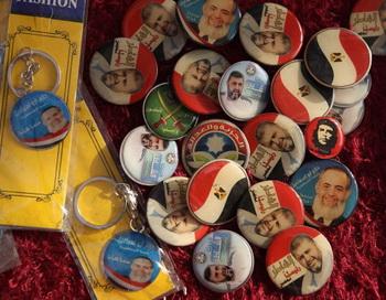 Значки с изображением кандидатов в президенты Египта. Фото: John Moore/Getty Images