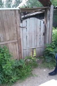 Ворота последниего деревенского дома в районе Раменки, Москва. Фото Игорь Андреев/Великая Эпоха