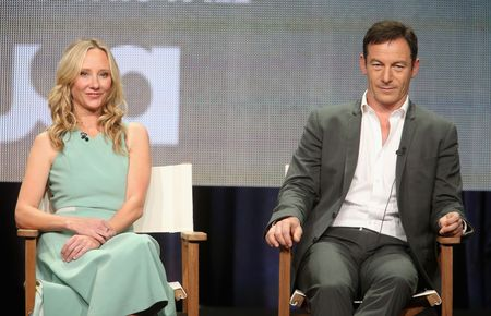 BEVERLY HILLS, CA - JULY 14:  Actors Anne Heche and Jason Isaacs speak onstage at the 'Dig' panel during the NBCUniversal USA Network portion of the 2014 Summer Television Critics Association at The Beverly Hilton Hotel on July 14, 2014 in Beverly Hills, California.  (Photo by Frederick M. Brown/Getty Images)