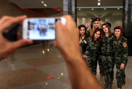 Female peshmerga fighters pose for a photo in Arbil, the capital of the Kurdish autonomous region in northern Iraq, on June 9, 2015. AFP PHOTO/SAFIN HAMED        (Photo credit should read SAFIN HAMED/AFP/Getty Images)