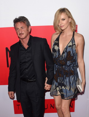 "LOS ANGELES, CA - MARCH 12:  Actors Sean Penn and Charlize Theron attend the premiere of Open Road Films' ""The Gunman"" at Regal Cinemas L.A. Live on March 12, 2015 in Los Angeles, California.  (Photo by Jason Merritt/Getty Images)"