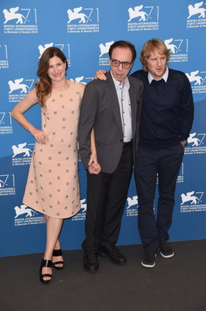 VENICE, ITALY - AUGUST 29:  (L-R) Actress Kathryn Hahn, director Peter Bogdanovich wearing a Jaeger-LeCoultre Master Hometime Aston Martin watch and actor Owen Wilson attend the 'She's Funny That Way' photocall during the 71st Venice Film Festival at the Palazzo del Casino on August 29, 2014 in Venice, Italy.  (Photo by Ian Gavan/Getty Images for Jaeger-LeCoultre)