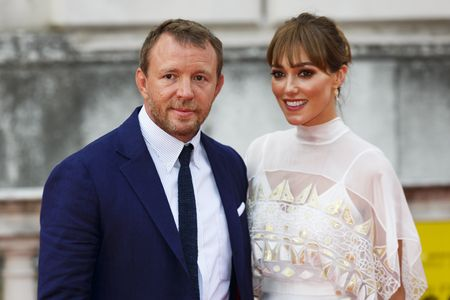 """LONDON, ENGLAND - AUGUST 07:  Guy Ritchie and Jacqui Ainsley attend the people's premiere of """"The Man From U.N.C.L.E"""" during Film4 Summer Screenings at Somerset House on August 7, 2015 in London, England.  (Photo by Tristan Fewings/Getty Images)"""