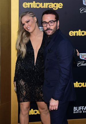 "Cast members Jeremy Piven and Ronda Rousey pose on arrival for the premiere of the film ""Entourage"" in Los Angeles, California on June 1, 2015.  AFP PHOTO / FREDERIC J. BROWN        (Photo credit should read FREDERIC J. BROWN/AFP/Getty Images)"