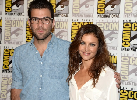 """Actors Zachary Quinto (L) and Hannah Ware pose on the press line for 20th Century Fox's """"Hitman: Agent 47"""", on the second day of the 45th annual Comic-Con, in San Diego, California July 25, 2014.  """"Hitman: Agent 47"""", a motioin picture about an elite and genetically engineered assassin, is based on the video game """"Agent 47."""" """"Hitman: Agent 47"""" is scheduled for release on February 27, 2015.   AFP PHOTO / ROBYN BECK        (Photo credit should read ROBYN BECK/AFP/Getty Images)"""