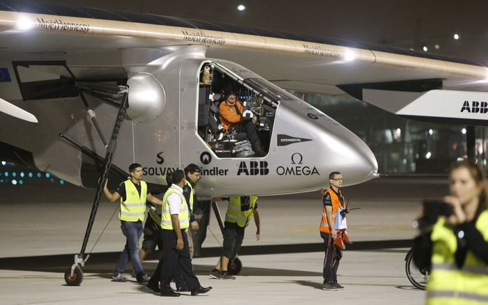 Pilot Andre Borschberg sits at the cockpit of Solar Impulse 2 after it landed in the Omani capital Muscat on March 9, 2015 completing the initial leg of its epic bid to become the first solar-powered plane to fly around the world, in a test of its pilots' endurance. The aircraft touched down in Muscat after nightfall, 13 hours and two minutes after taking off from Abu Dhabi. AFP PHOTO / MOHAMMED MAHJOUB (Photo credit should read MOHAMMED MAHJOUB/AFP/Getty Images)