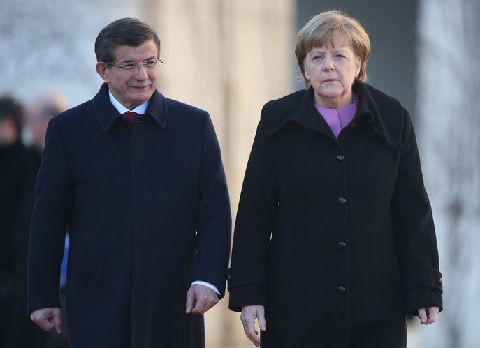 Премьер-министр Ахмет Давутоглу и канцлер Германии Ангела Меркель. Фото: Sean Gallup/Getty Images