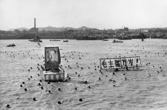 """A picture released by the Chinese official news agency shows some 5,000 Chinese following Chairman Mao Zedong's example swimming 02 September 1967, in the Yangtze river, near Wuhan, displaying floating portraits of the Great Helmsman and slogans calling for him a """"10,000 year"""" life. Right after swimming in the Yangtze river, Mao went back to Beijing to head the Great Proletarian Cultural Revolution against his former comrade Lin Piao and Deng Xiaoping, bringing Red China close to a civil war. CHINA OUT AFP PHOTO/XINHUA (Photo credit should read STR/AFP/Getty Images)"""