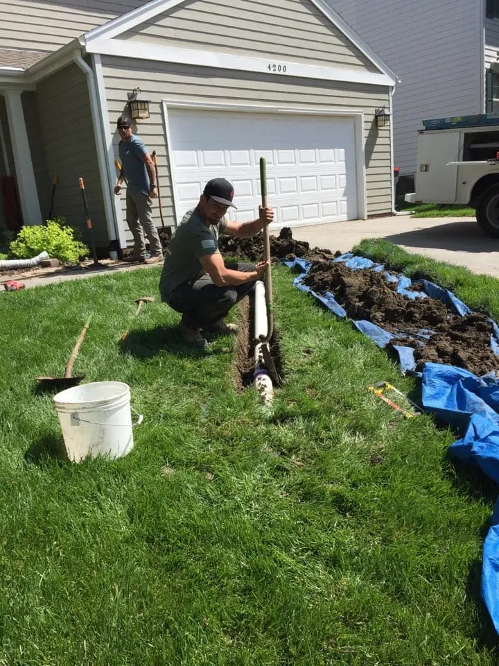 Man installing an exterior drainage system