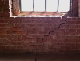 structural crack - stairstep crack in brick wall