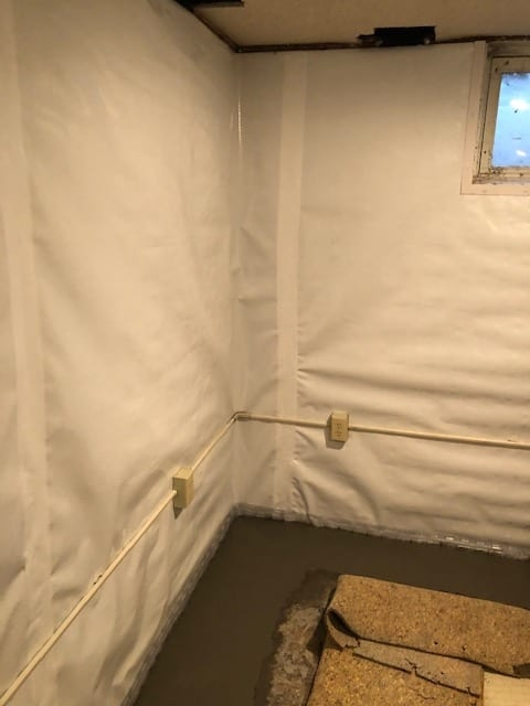 Photo of a basement vapor barrier