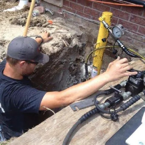 Driving steel pipe beneath foundation (push piers)