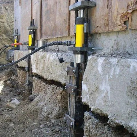 Lifting home foundation with push piers and hydraulic jacks