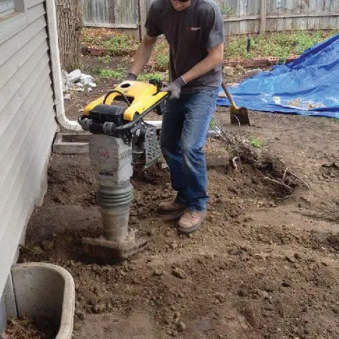Replacing and compacting soil after push pier installating