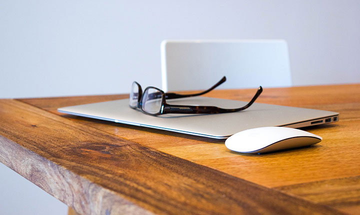 A pair of glasses sitting on top of a closed laptop. Simplicity in working_Equate_Feng_shui_NZ