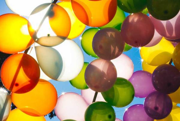 Lots of balloons on a bright sunny day