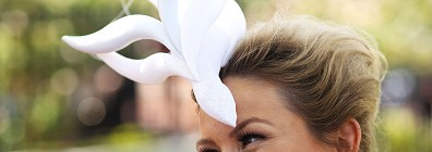 Enquiry: Why do ladies wear huge hats with flora at racing events?