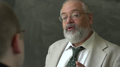 stock-footage-professor-and-student-talking-in-a-classroom-close-up