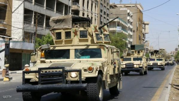 Iraqi army armoured vehicles patrol a street in Baghdad's commercial district of Karrada on August 11, 2014 as security measures have been reinforced across the capital after Iraq's prime minister said he would sue the president in a desperate bid to cling to his job. A defiant Nuri al-Maliki made his shock announcement after three days of US strikes against jihadist militants in the north of Iraq and in spite of mounting calls for him to step aside.   AFP PHOTO / SABAH ARAR        (Photo credit should read SABAH ARAR/AFP/Getty Images)