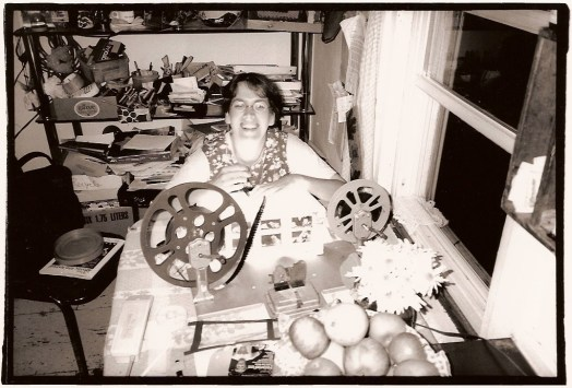 Helen Hill painting on 16mm film in her kitchen at 5515 Falkland St., Halifax, September 16, 2000. (Photo by John Porter)