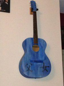 """Dad's old guitar that I turned into art several years ago. It says """"Father"""" and """"Daughter."""" Circa 2008."""