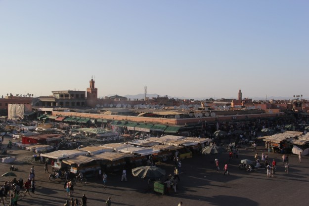 View of Jemaa el-Fna from a second-story café, just before sunset.