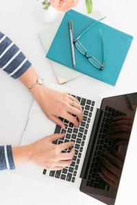 Content Writer Ericka Watson Typing