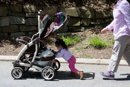 Pushing her Stroller