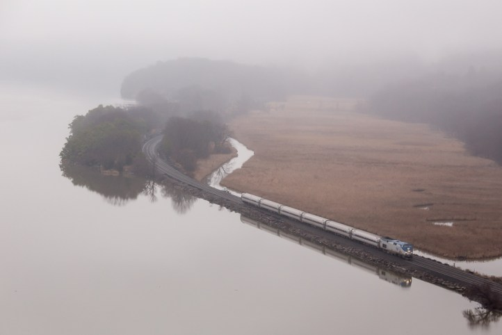 An Amtrak Empire service train emerges from the fog as it passes under the Bear Mountain Bridge enroute to New York on December, 30, 2015.