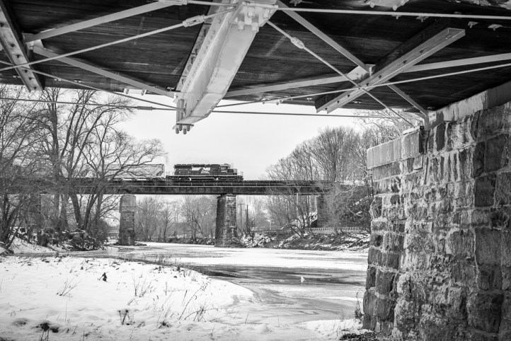 A Norfolk Southern local crosses the Rarity River on the former Lehigh Valley bridge at Neshanic, NJ.