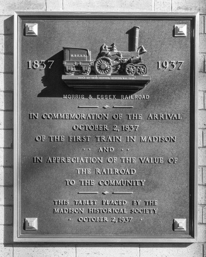 """A plaque at Madison station, from where the first """"commute"""" stated."""