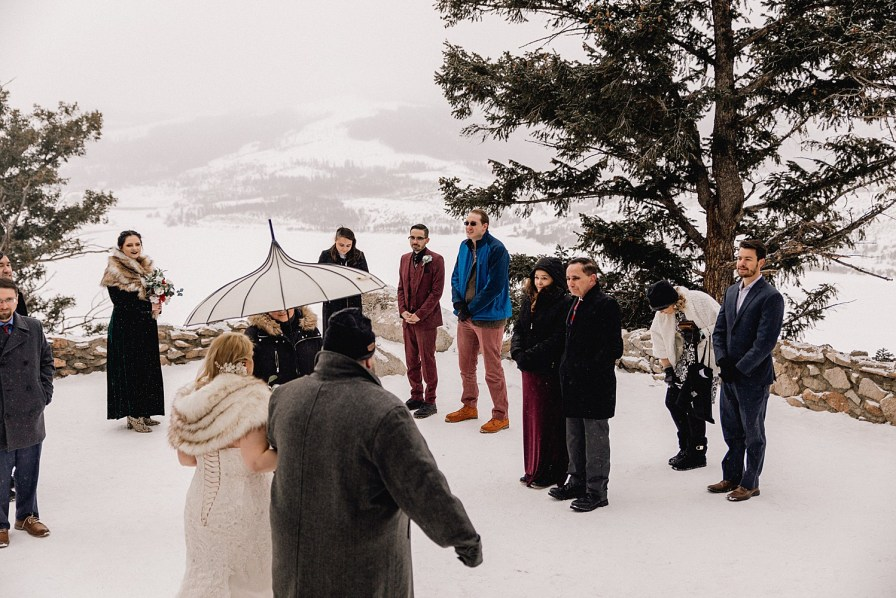guests watch bride walking down aisle at Sapphire Point