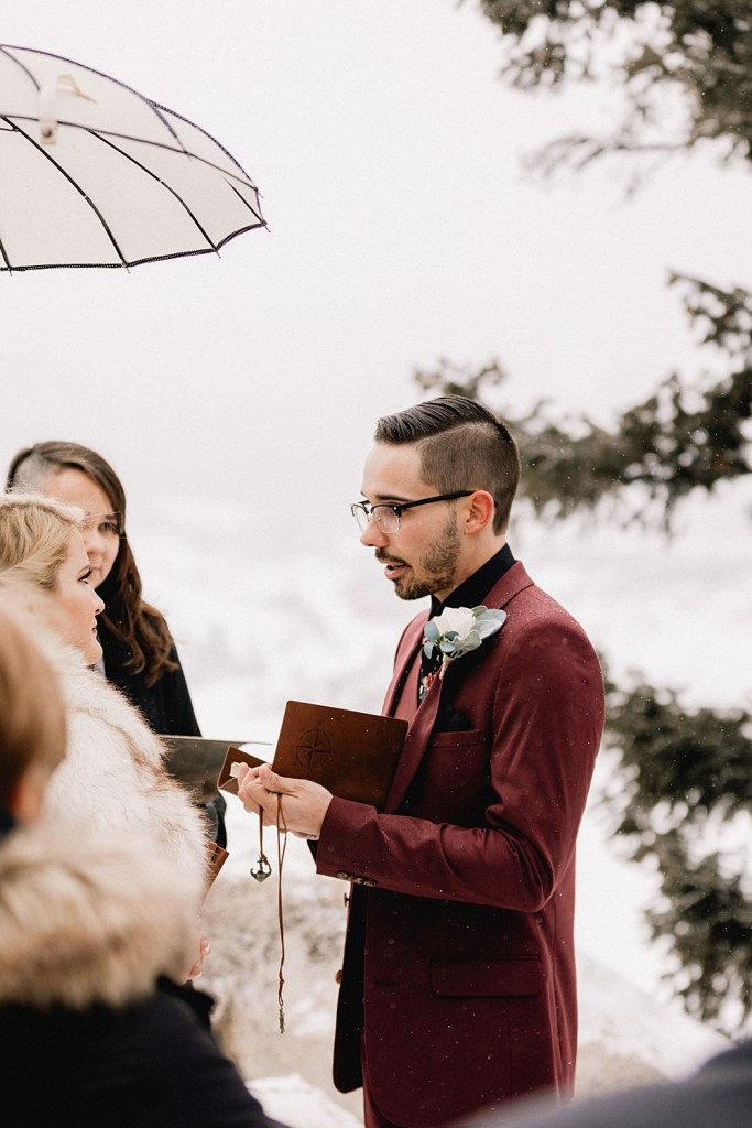 Groom reads his vows to bride at Sapphire Point elopement