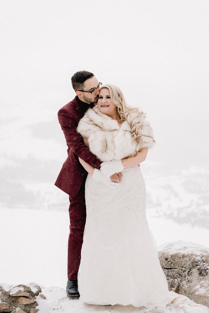 Winter attire for snowy Sapphire Point elopement