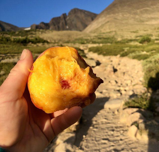 erin demarco savoring an in season colorado peach