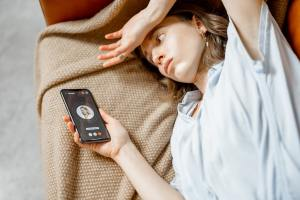 Woman feel bad lying on sofa and call a doctor