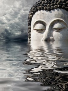 Buddha head reflected in water