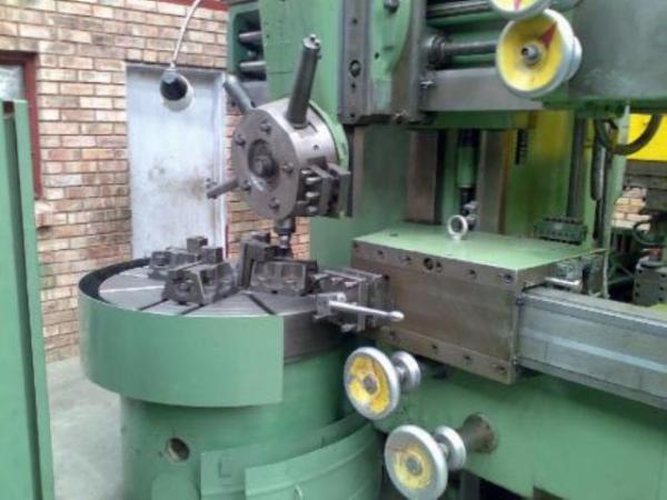 STANKO  model 1512 elevating rail vertical boring mill with side head.