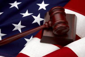 Boston Massachusetts ERISA attorney scale on flag