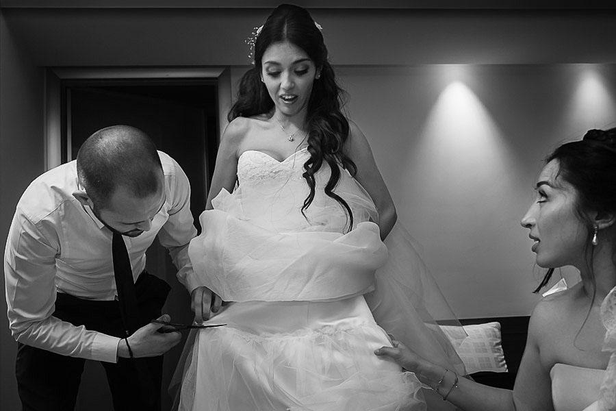 Crazy wedding: bride getting her wedding dress cut