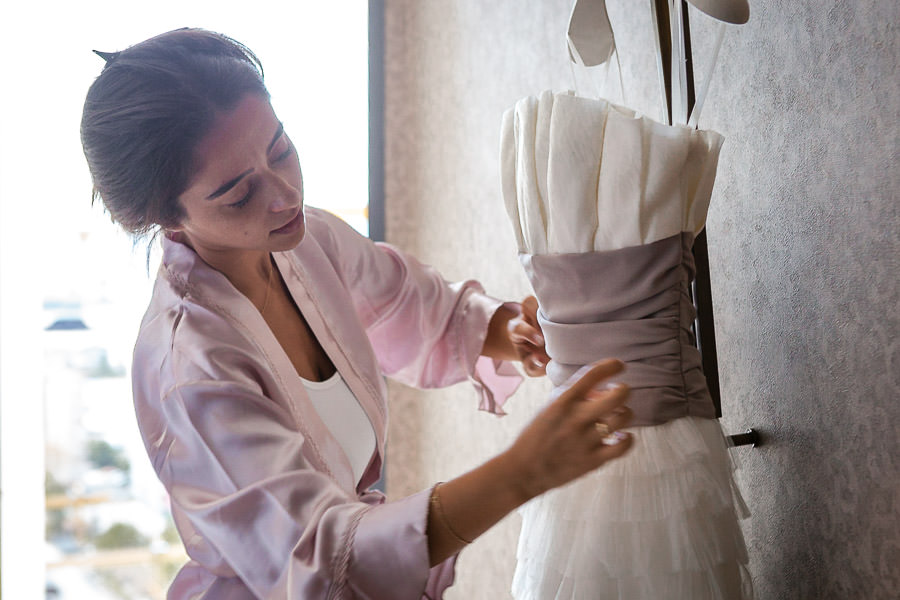 bride checking the wedding dress before Divan Istanbul Asia wedding