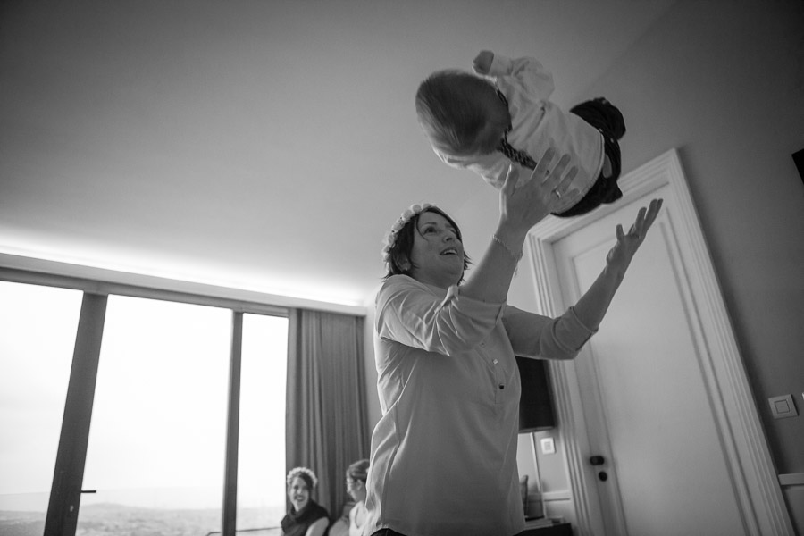 istanbul elopement: mom throwing toddler in the air