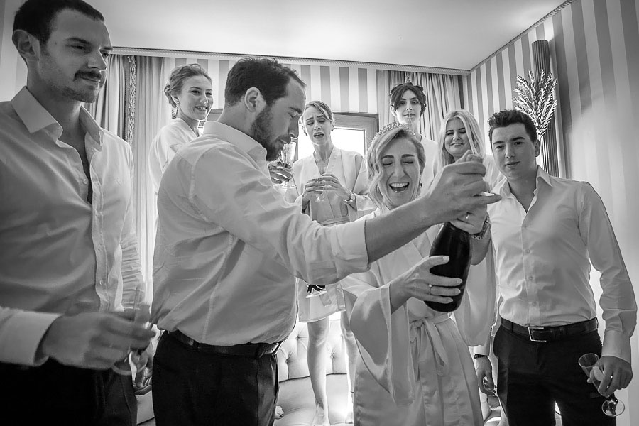 Bride opening a champagne